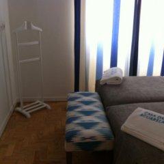 Отель Casa das Aguarelas - Apartamentos удобства в номере