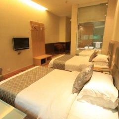 Guanglian Business Hotel Zhongshan Xingbao Branch комната для гостей