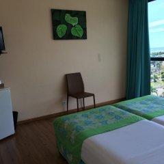 Отель Tahiti Airport Motel 2* Стандартный семейный номер с различными типами кроватей фото 6