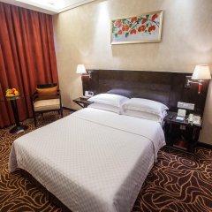 Huashi Hotel комната для гостей