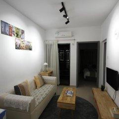Апартаменты Shenzhen Wozhan Apartment K K Mall комната для гостей фото 5