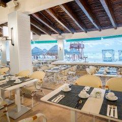Отель Omni Cancun Hotel & Villas - Все включено Мексика, Канкун - 1 отзыв об отеле, цены и фото номеров - забронировать отель Omni Cancun Hotel & Villas - Все включено онлайн гостиничный бар фото 3