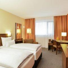 Отель NH Collection Frankfurt City 4* Улучшенный номер с различными типами кроватей фото 9