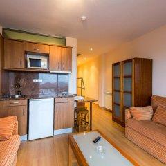 Отель Astuy Apartamentos Арнуэро в номере фото 2
