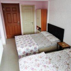 Отель Caner Pansiyon комната для гостей фото 4