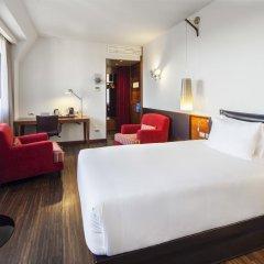 Отель NH Milano Touring 4* Улучшенный номер разные типы кроватей фото 18