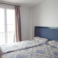 Отель Apartahotel Playa Conil Испания, Кониль-де-ла-Фронтера - отзывы, цены и фото номеров - забронировать отель Apartahotel Playa Conil онлайн комната для гостей фото 3