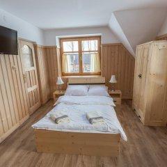 Отель Zakątek Pod Smrekami Косцелиско комната для гостей