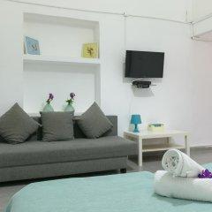 Апартаменты Hacarmel Apartment Тель-Авив комната для гостей фото 4