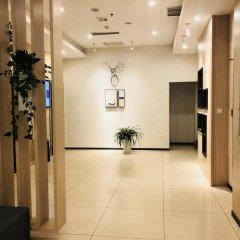 Отель Hanting Hotel Beijing Water Cube Китай, Пекин - отзывы, цены и фото номеров - забронировать отель Hanting Hotel Beijing Water Cube онлайн интерьер отеля