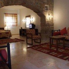 Отель Taybet Zaman Hotel & Resort Иордания, Вади-Муса - отзывы, цены и фото номеров - забронировать отель Taybet Zaman Hotel & Resort онлайн интерьер отеля фото 2