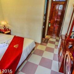 Отель Nhi Nhi 3* Номер Делюкс фото 4
