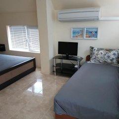 Апартаменты Ahinora Apartments Поморие комната для гостей фото 5
