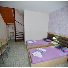 Апартаменты Anna Christina Apartments Метаморфоси комната для гостей фото 5