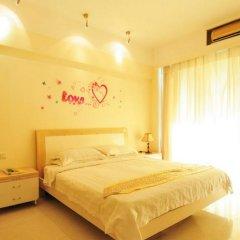 Апартаменты Fenghuang Rujia Holiday Apartments - Sanya Bay Branch комната для гостей фото 3
