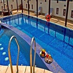 Arcadia Hotel Apartments бассейн фото 2