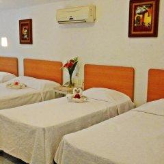 Hotel Olinalá Diamante 3* Стандартный семейный номер с двуспальной кроватью фото 2