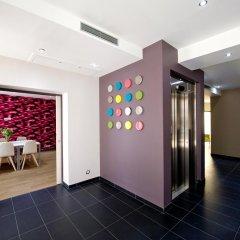 Отель Serotel Suites Франция, Париж - отзывы, цены и фото номеров - забронировать отель Serotel Suites онлайн интерьер отеля