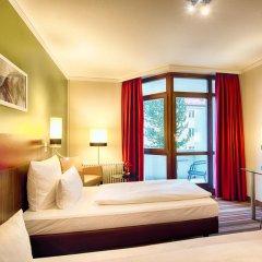 Отель Leonardo Hotel & Residenz München Германия, Мюнхен - 11 отзывов об отеле, цены и фото номеров - забронировать отель Leonardo Hotel & Residenz München онлайн комната для гостей фото 2