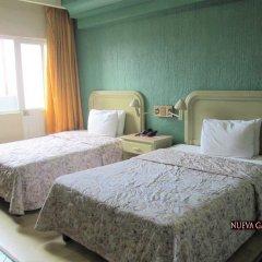 Hotel Nueva Galicia 3* Номер Делюкс с различными типами кроватей фото 3