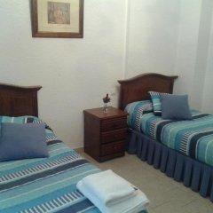 Отель Hostal El Callejon комната для гостей фото 3
