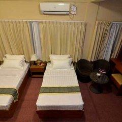 Kyi Tin Hotel 3* Улучшенный номер с 2 отдельными кроватями фото 3