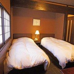 Отель Yufu Ryochiku 3* Стандартный номер фото 5