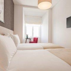 Отель Feels Like Home Rossio Prime Suites Лиссабон комната для гостей фото 4