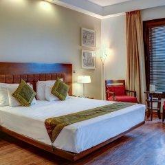 Отель Treebo Tryst Amber Стандартный номер с двуспальной кроватью фото 6
