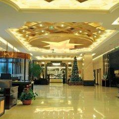 Отель Juny Oriental Hotel Китай, Пекин - отзывы, цены и фото номеров - забронировать отель Juny Oriental Hotel онлайн интерьер отеля