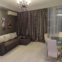 Апартаменты Most City Area Apartments комната для гостей
