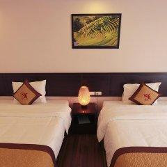 Отель Nguyen Dang Guesthouse Стандартный семейный номер с двуспальной кроватью фото 4