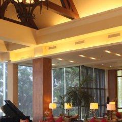 Отель Taal Vista Hotel Филиппины, Тагайтай - отзывы, цены и фото номеров - забронировать отель Taal Vista Hotel онлайн интерьер отеля фото 3