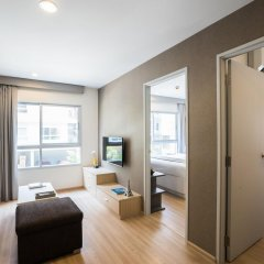 Отель The Grass Serviced Suites by At Mind Люкс с 2 отдельными кроватями фото 5