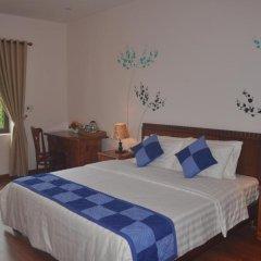 Отель Tra Que Riverside Homestay 2* Улучшенный номер с различными типами кроватей фото 11