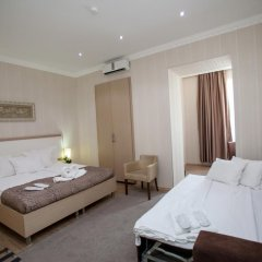 Отель Rustaveli Palace Стандартный семейный номер с двуспальной кроватью фото 10