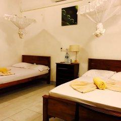 Отель Muhsin Villa Шри-Ланка, Галле - отзывы, цены и фото номеров - забронировать отель Muhsin Villa онлайн комната для гостей фото 3