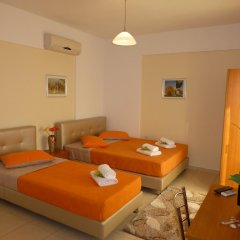 Апартаменты Pavloudis Apartments комната для гостей фото 4