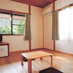 Отель Iyashi no Minshuku Tonton Якусима комната для гостей фото 3