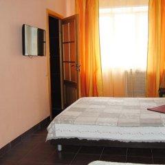 Гостиница Четыре комнаты в Омске отзывы, цены и фото номеров - забронировать гостиницу Четыре комнаты онлайн Омск комната для гостей фото 5