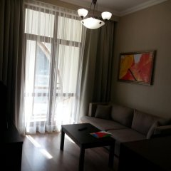 Апартаменты Времена Года Красная поляна комната для гостей фото 2