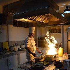 Отель Amba Ayurveda Boutique Hotel Шри-Ланка, Пляж Golden Mile - отзывы, цены и фото номеров - забронировать отель Amba Ayurveda Boutique Hotel онлайн питание