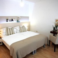 Апартаменты Rooms & Apartments Henrik комната для гостей