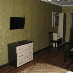 Мини-Отель Уют Стандартный семейный номер с различными типами кроватей фото 2