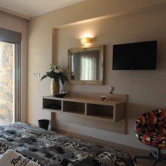 Отель Royalty Suites удобства в номере