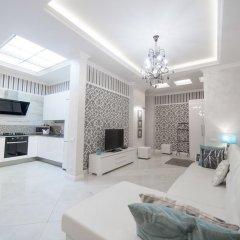 Апартаменты Royal Apartments Minsk комната для гостей фото 4