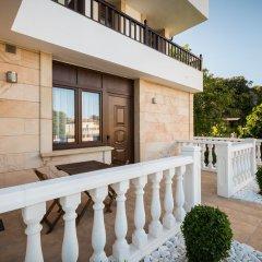 Отель Apartamentos La Bolera Испания, Арнуэро - отзывы, цены и фото номеров - забронировать отель Apartamentos La Bolera онлайн балкон