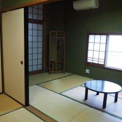 Отель Sudomari Minshuku Friend Якусима комната для гостей фото 3