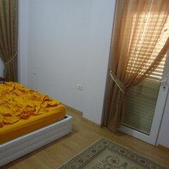 Отель Toti Apartments Албания, Тирана - отзывы, цены и фото номеров - забронировать отель Toti Apartments онлайн комната для гостей фото 3