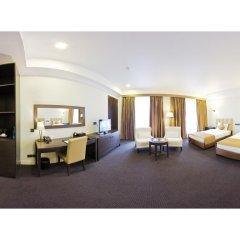 Отель Амбассадор 4* Стандартный семейный номер с двуспальной кроватью фото 2